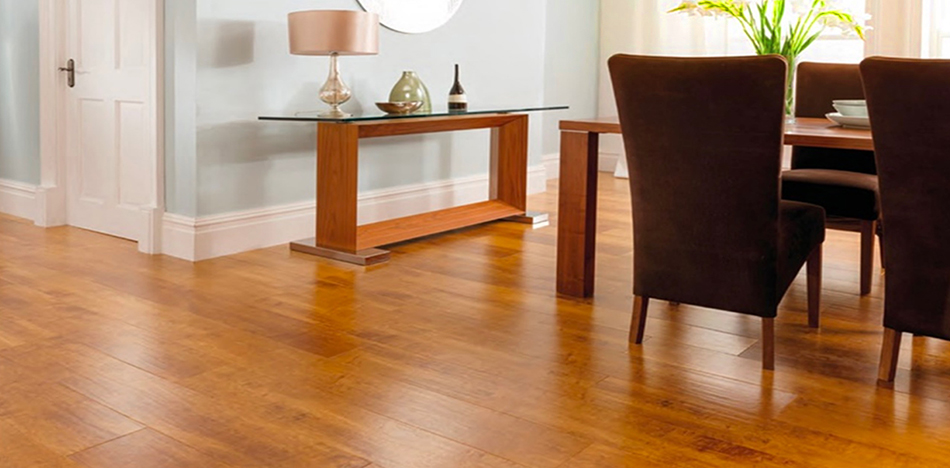 The rich tones and distinctive patterns of a laminate floor resembling a handsome cherry hardwood for this dining room from Foster Flooring