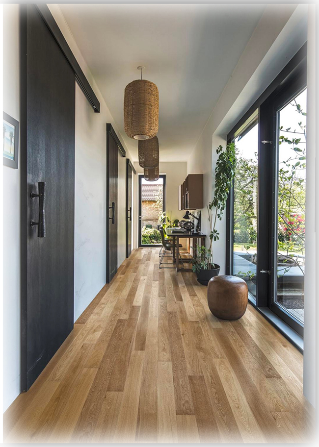 Depending on whether a tinted or clear stain or finish is used, red or white oak flooring is a versatile and popular choice with  a fairly substantial hardness rating suitable for most usual foot traffiic within the modern home.