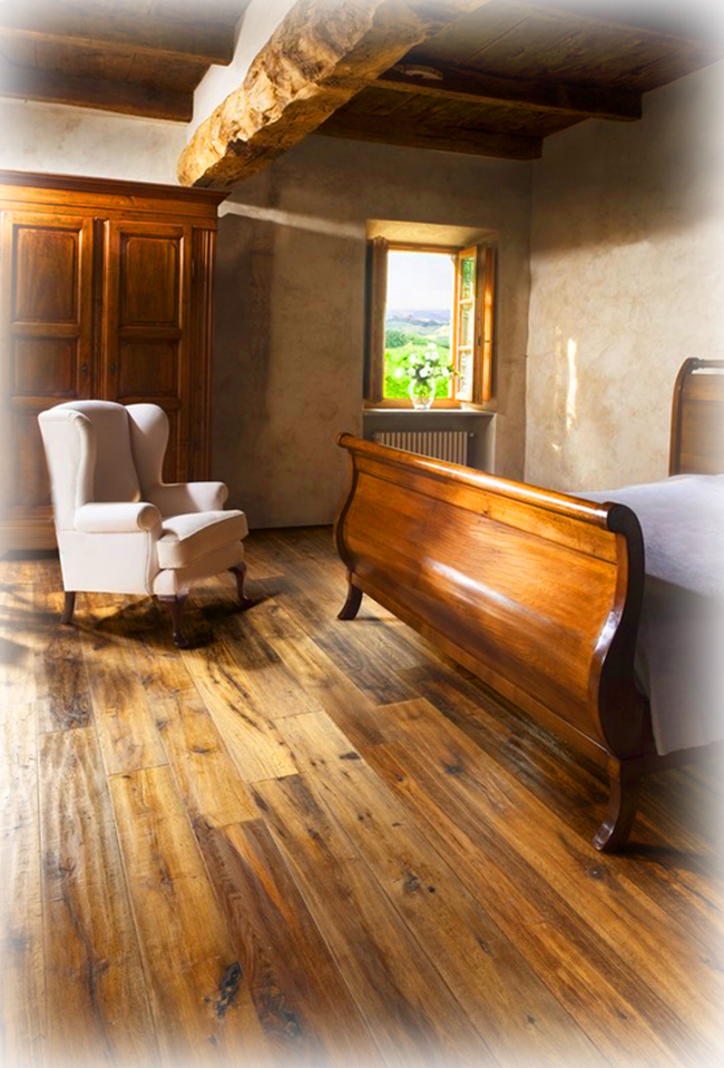 Another example of how wide plank red oak flooring perfectly complements this turn-of-the-century farmhouse bedroom.